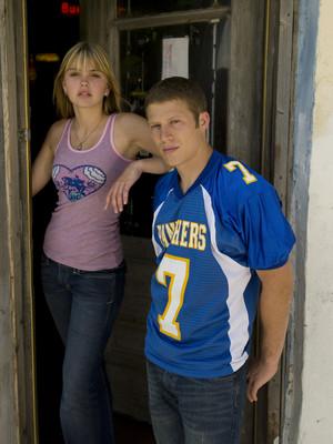 Aimee Teegarden as Julie Taylor and Zach Gilford as Matt Saracen