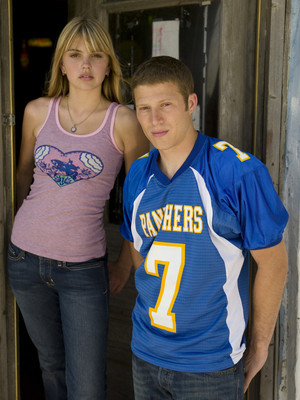Aimee Teegarden as Julie Taylor and Zach Gilford as Matt Saracen