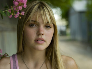 Aimee Teegarden as Julie Taylor