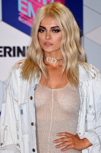 Bebe Rexha Hintergrund probably with a portrait entitled Bebe Rexha