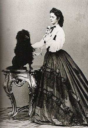 Empress Elizabeth in 1864 playing with a dog