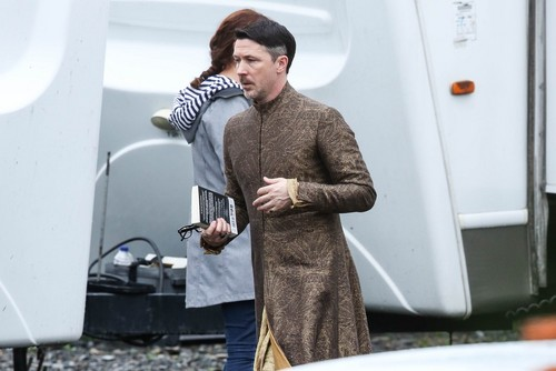 Game of Thrones achtergrond possibly with a business suit, an outerwear, and a straat called Game of Thrones- Season 7- Filming