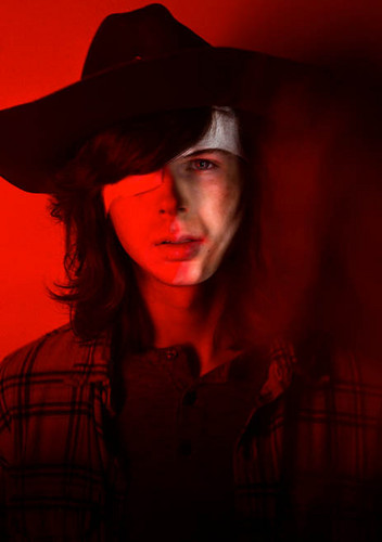 the walking dead wallpaper possibly with a fedora entitled Season 7 Character Portrait ~ Carl Grimes