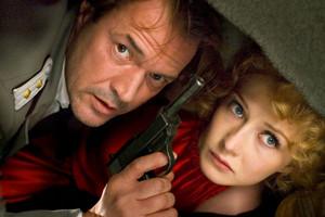 Sebastian Koch as Ludwig Muntze and Carice वैन, वान Houten as Ellis de Vries