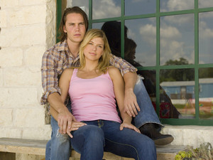 Taylor Kitsch as Tim Riggins and Adrianne Palicki as Tyra Collette