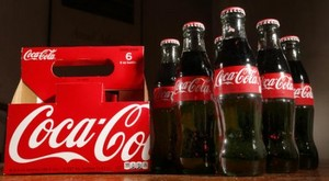 coca cola tops 2q profit forecasts