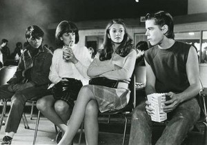 Johnny, Marcia, Cherry and Ponyboy at the movies