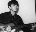 A 13 year-old John playing his guitar :) - the-beatles photo