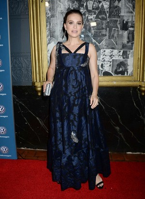 Attending the 21st Annual Huading Global Film Awards at The Theatre at Ace Hotel in Los Angeles (Dec