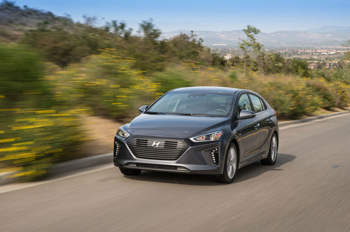Hyundai Ioniq Hybrid wallpaper entitled 2017 Hyundai Ioniq Hybrid front three quarter in motion