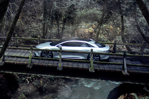 Lucid Air wallpaper entitled Lucid Motors Air side view overhead bridge