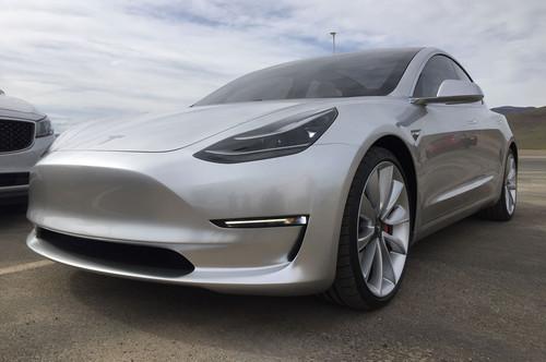 Tesla Model 3 wallpaper entitled Tesla Gigafactory Model 3 front three quarter