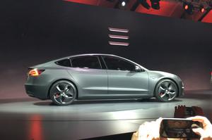 Tesla model 3 live gray side view