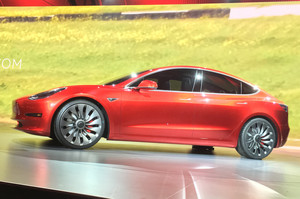 Tesla Model 3 live red side view