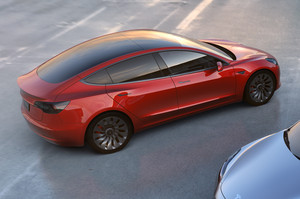 Tesla Model 3 rear side view from above in red