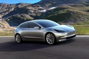 Tesla Model 3 with mountain