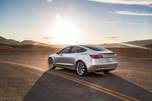 rear three quarter sunset 2018 Tesla Model 3 60D AWD electric sport luxury sedan