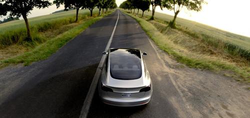 Tesla Model 3 60D AWD wallpaper entitled Tesla Model 3 electric sport sedan 60D AWD silver overhead glass roof