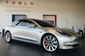 silver three quarters 2018 Tesla Model 3 70D AWD electric sport sedan