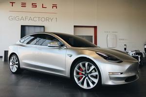 silver three quarters 2018 Tesla Model 3 70D AWD electric sport sedan