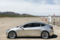 silver side human height 2018 Tesla Model 3 70D AWD electric sport sedan