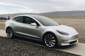 front three quarters silver 2018 Tesla Model 3 70D AWD electric sport sedan