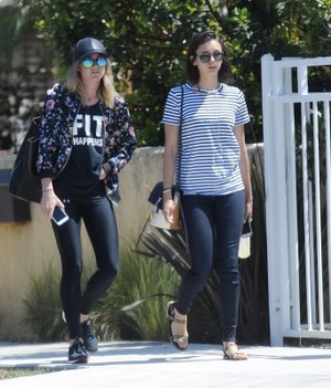 Nina Dobrev out for a walk with a friend in Los Angeles