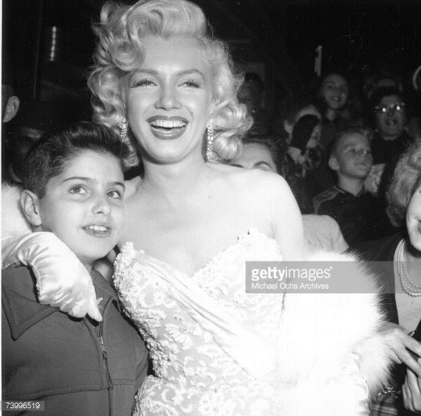 Posing With A Young Fan