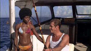 Sir Roger Moore And Gloria Hendry