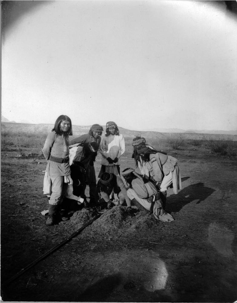 Apache men count the score during a hoop