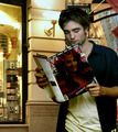 He reading a Magazine of Rebecca Ferratti - hot-women photo