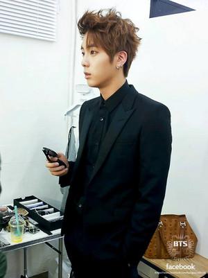 Jin in a tuxedo