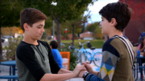 Jonah and Cyrus hold hands (kind of)