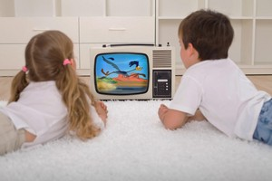 Kids watching Road Runner toon on the tv