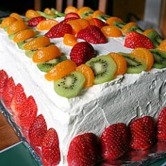 A Cream Cake With A Fruit Topping