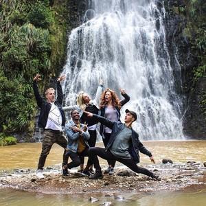 TNS cast under waterfall