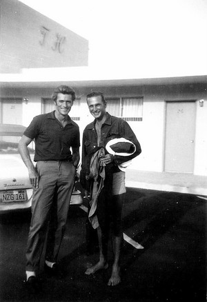 Candid shot of Clint Eastwood and Eric Fleming outside a hotel (September 1959)