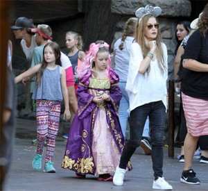 Lisa,Ben and the twins at Disneyland.