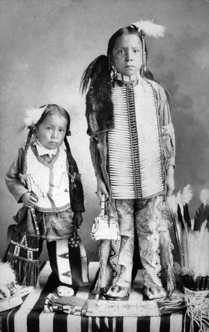 Dakota Sioux boys on a woven blanket 1880 -1910