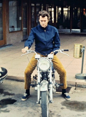 Clint Eastwood photographed on his motorcycle late 1960s