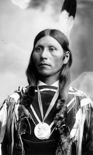 Native American Ute man wearing a peace medal 1880-1900