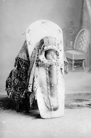 Native American baby (Ute) tightly secured in its cradleboard by Kohlberg 1870-1900