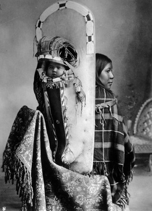 Unidentified Native American Ute woman wearing a cradleboard with her baby (Boston 1885-1892)