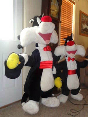 two lifesize plush Sylvester the cat magicians