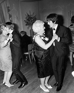 Ringo and George dancing with their mothers
