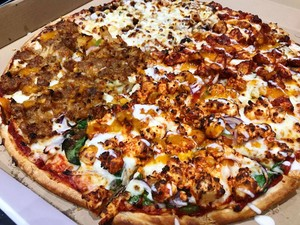 pizza topped with indian curries1
