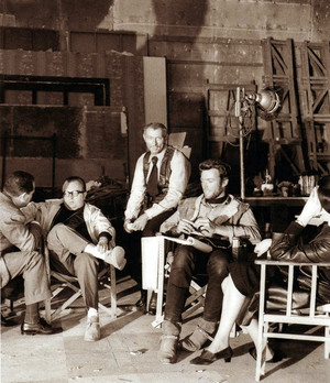 Director Sergio Leone, Lee Van Cleef and Clint Eastwood on the set of For a Few Dollars More