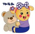 Miss La Sen sitting and holding teddy