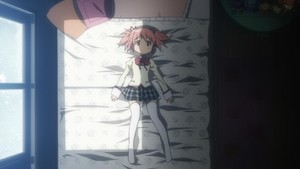 Madoka laying on her بستر