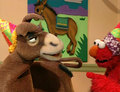 Elmo Playing Pin the Tail on the Donkey (Elmo's World)